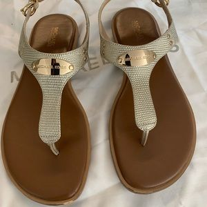 Michael Kors used once Size 7.5 gold